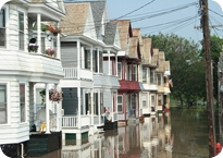 Row of houses with major street flooding