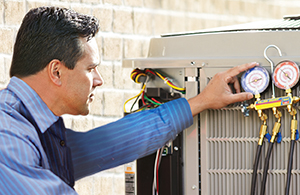 Petro expert adjusting air conditioning equipment
