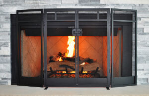 Gas fireplace with fake wooden logs and flames