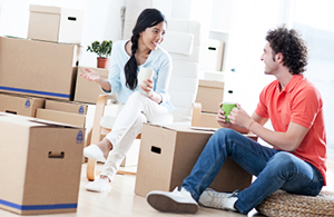 couple unpacking boxes in their home