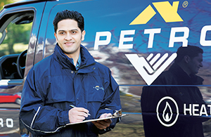 petro employee in front of a truck
