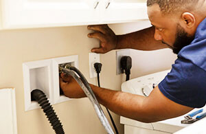 Petro expert installing a washer and dryer