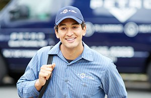 petro home services employee in front of truck