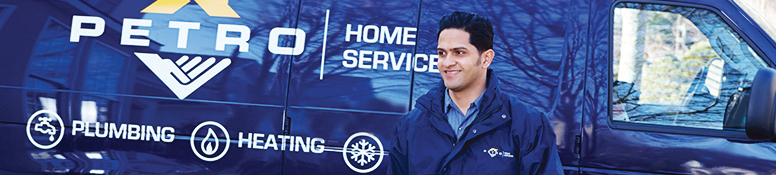 petro home services employee in front of a truck